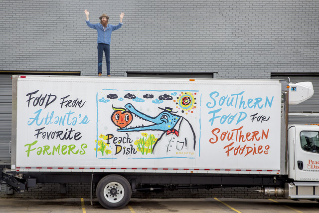 atlanta street artist kyle brooks standing on top of peachdish delivery truck