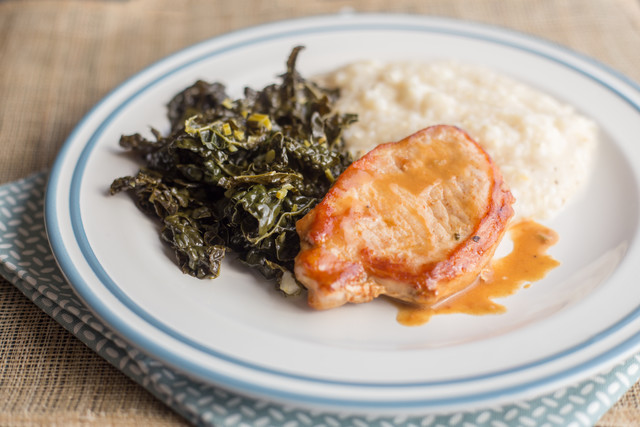 Glazed Pork Chop with grits and Greens