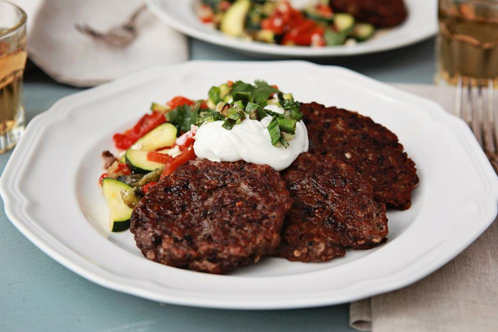 Black Bean Cakes with Zucchini, Roasted Pepper and Cotija Cheese Salad