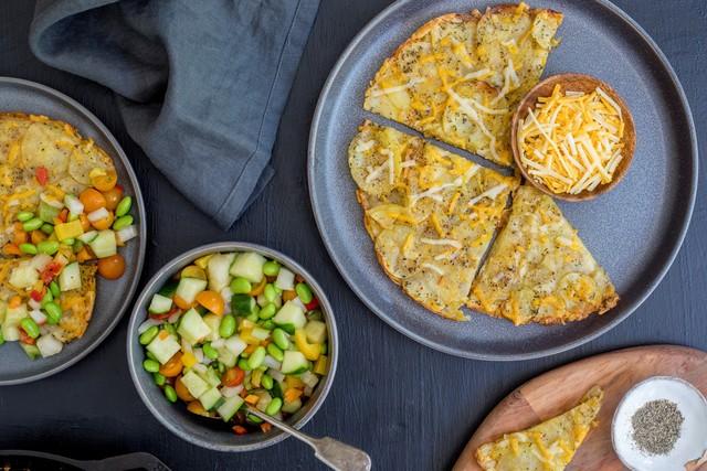 'Cheesy' Potato Galette with Edamame, Cucumber & Tomato Salad