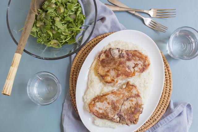 Berkshire Pork Chops & Grits with Arugula & Muscadine Salad