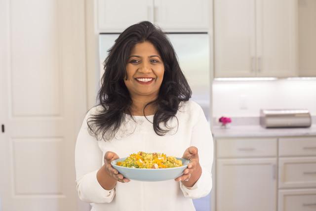 Chef Asha Gomez with her Weeknight Fancy Chicken and Green Bean Verraka