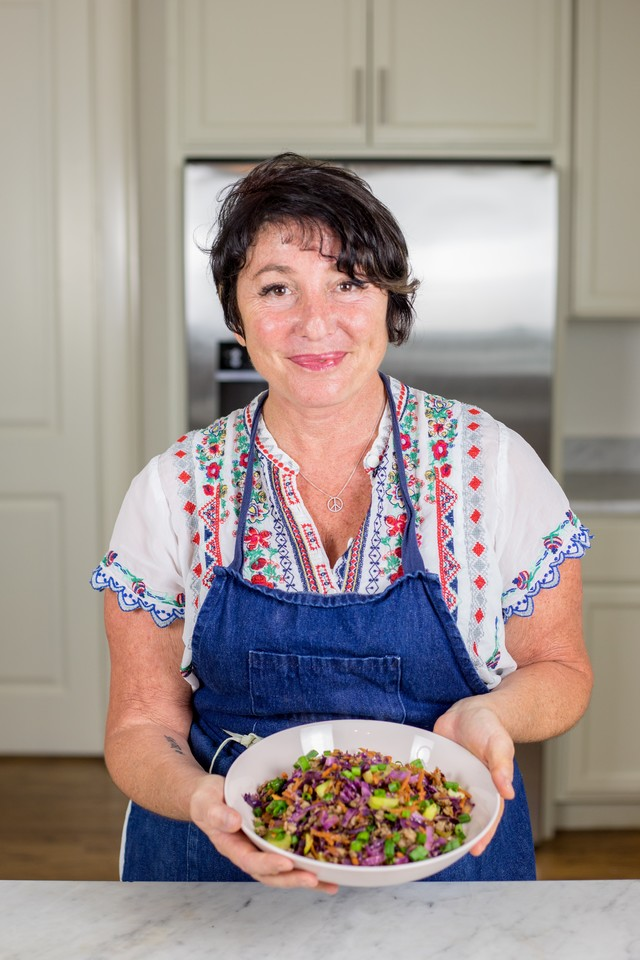 souper jenny levison holding her egg roll in a bowl dish