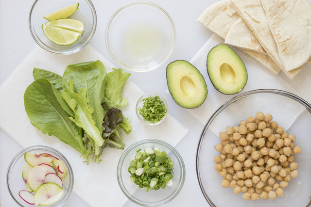 Drained chickpeas; halved avocado; lime juice; lime zest; lime wedges; sliced onion; sliced radish; halved pita