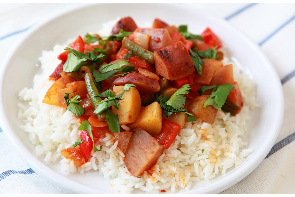 Spicy Fingerling Potato, Green Bean and Mixed Pepper Curry over Basmati Rice with Cilantro