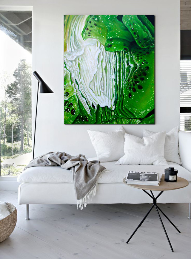 a white living room with angela faustina's green painting
